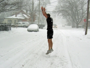 Andy O'Rourke, co-owner of Steel City CrossFit does burpees in a blizzard
