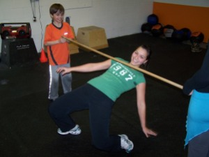 MC takes a spill during CrossFit Limbo