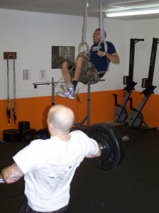 Mid-pull on the clean and muscle-up