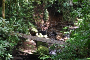 That's Dave doing knees-to-elbows...on a bridge...in the JUNGLE!
