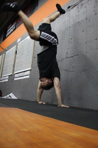 Is Brian kicking up or coming down from a handstand?