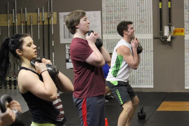 Jenna, Alex and Brendan perform goblet squats