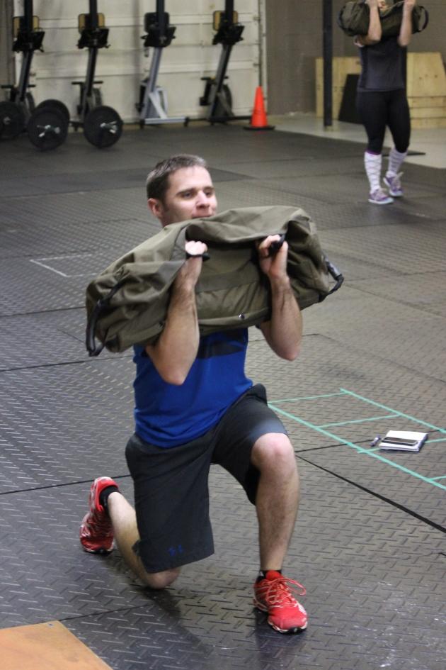 Matt lunges with a sandbag