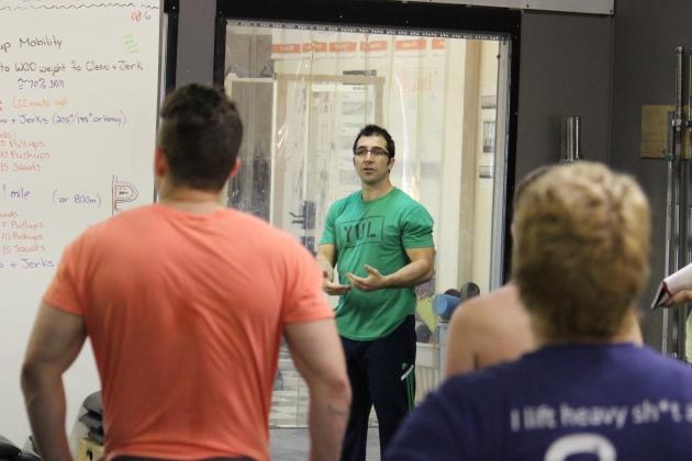 Coach Mario explaining the workout